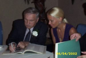 George Barris signs a book for IM member Kim Smith in 2002.